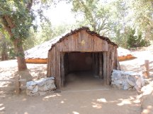 """The entrance to the Chaw'se site """"hun'ge"""" or roundhouse"""